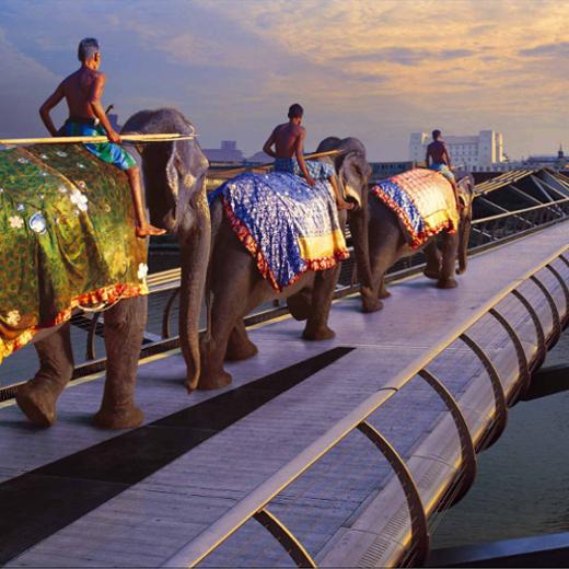 Tribesman riding Elephants on the Millennium bridge London.